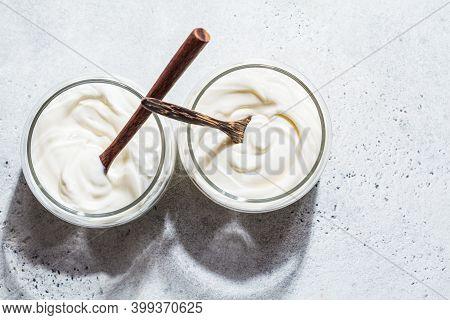 Homemade Yogurt In Glass Jars, Light Background, Copy Space. Yoghurt Preparation Concept.