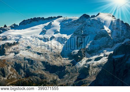 Warm sunny day in the Alps. The Passo-Pordoi pass. Pordoi is a mountain pass of the Dolomites, located between the Sella mountain range and the Marmolada mountain