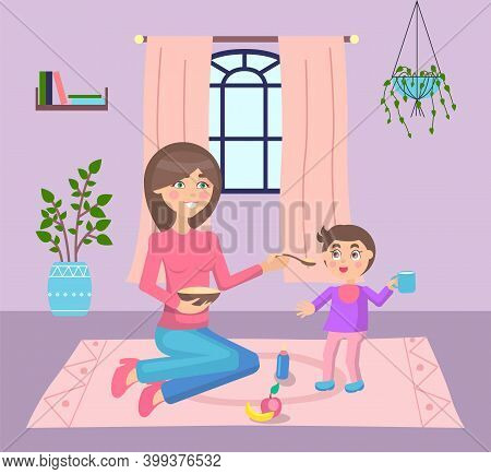 Young Mother Feeding Her Son, Sit At Floor Near Standing Kid. Little Boy Holding Cup And Smiling. Lu
