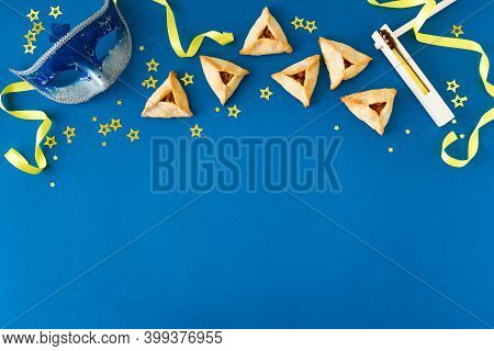 Purim Celebration Concept (jewish Carnival Holiday) On Blue Background, Top View, Copy Space. Purim