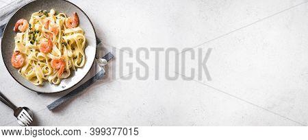 Shrimp Fetticcine Pasta. Italian Pasta With Shrimps And Cream Alfredo Sauce, Top View, Copy Space, B