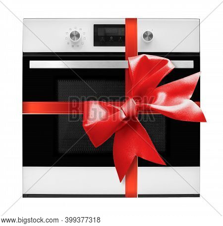 The Electric Oven Gift Tied Red Bow On A White Background. It Is Isolated, The Worker Of Paths Is Pr