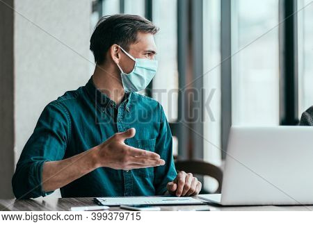 Employees In Protective Masks Discussing Work Issues.