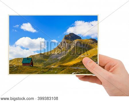 Hand and Durmitor Montenegro image (my photo) isolated on white background
