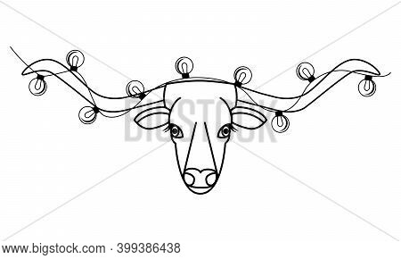 The Head Of A Cow With Long Horns. Christmas Lights On The Horns Of A Bull. Chinese 2021 New Year. B