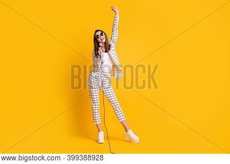 Full Length Body Size Photo Of Girl Holding Mic Singing Keeping Hand Up Smiling Wearing Sunglass Iso