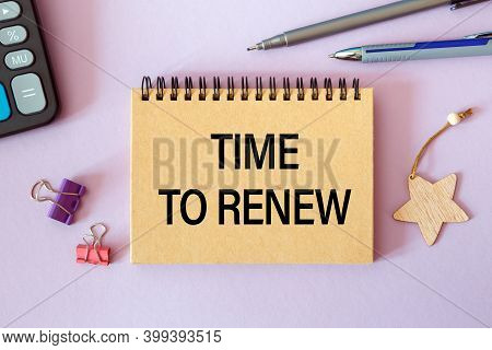 Time To Renew Is Written In A Notebook On An Office Table With Office Supplies.