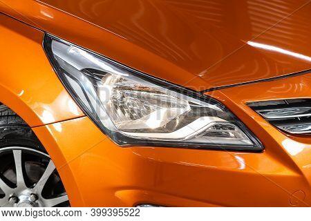 Novosibirsk, Russia - December 12, 2020: Hyundai Solaris, Macro View Of Modern Orange Car Xenon Lamp