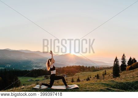 Young Woman Doing Complex Hatha Yoga Exercise With Namaste Asana. Amazing Yoga Plank Pose Outdoors L