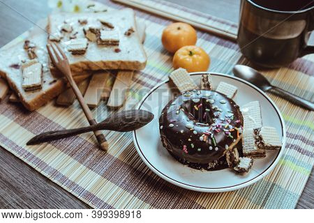 Rustic Breakfast, Donut Is Placed On An Artistic Table, Soft Focus.