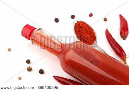A Bottle Of Hot Sauce With Hot Pepper On A White Background