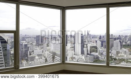 Skyscrapers In Bangkok City Town Through The Mirror Window, Cityscape View From The Building