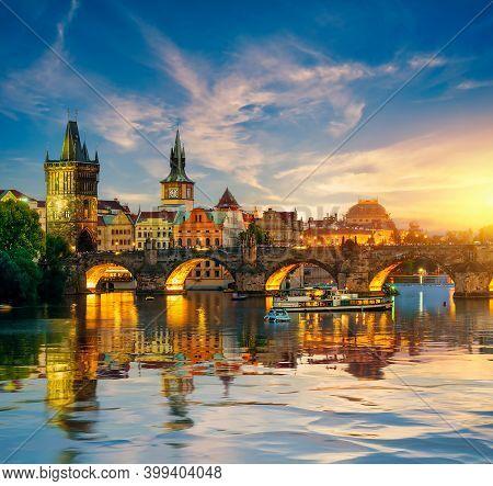 Fiery Sunset Over Charles Bridge On River Vltava In Prague