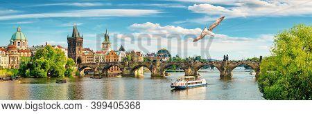 Tourist Boat Near The Charles Bridge In Prague