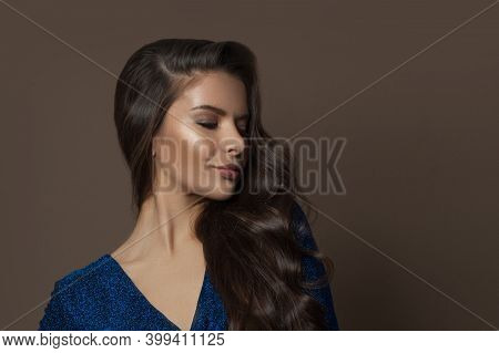 Young Beautiful Model Woman Brunette With Long Curly Hair On Brown Background, Fashion Beauty Portra