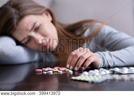 Young Woman With Pile Of Antidepressants Planning To Kill Herself, Committing Suicide, Suffering Fro