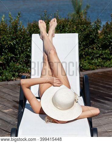 Beautiful Nude Woman Lies On A Sun Lounger
