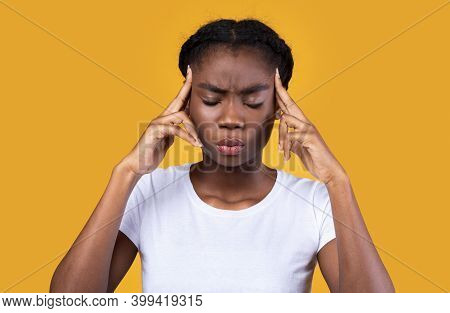 Let Me Think. Thoughtful African American Young Lady Thinking Massaging Temples With Eyes Closed Pos