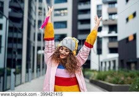Young Woman Dancing Outdoors On Street, Tik Tok And Coronavirus Concept.