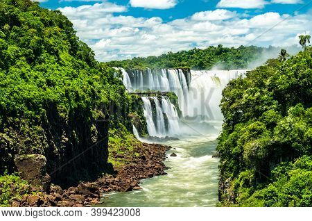 View From The Jungle To Iguazu Falls, The Largest Waterfall In The World. Unesco World Heritage In B
