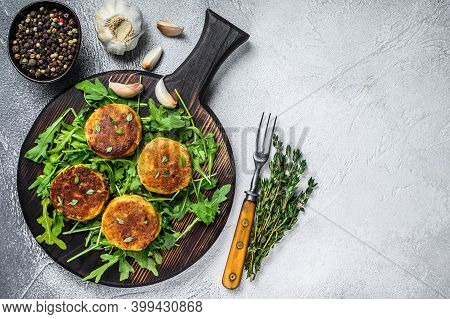 Veggie Patty Cutlet With Lentils, Vegetables And Arugula. White Background. Top View. Copy Space