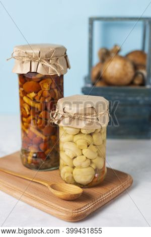 Two Glass Jar With Tasty Homemade Marinated Pickled Honey Mushrooms, Champignons With . Vegetarian F