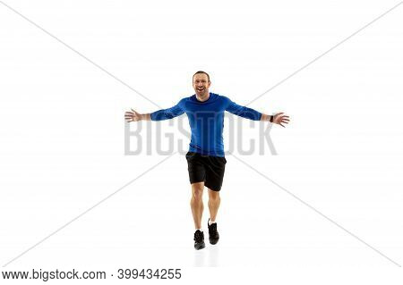 Expression. Caucasian Professional Jogger, Runner Training Isolated On White Studio Background. Musc