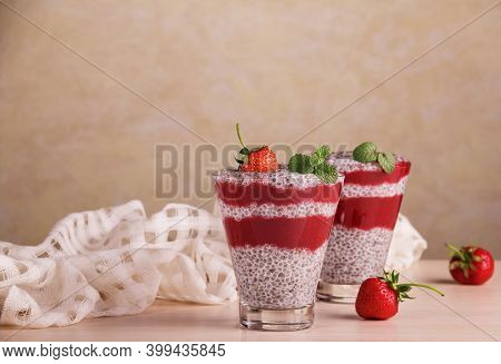 Delicious Healthy Dessert Made From Chia Seeds And Strawberries On The Table In Beautiful Glasses