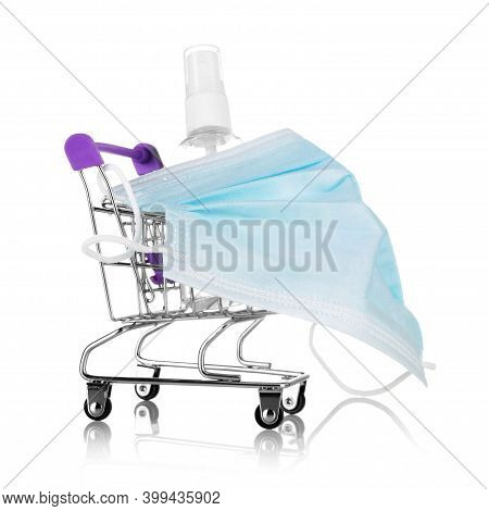 Safe Shopping Concept. Shopping Cart Wearing A Mask And Sanitizer Isolated On White Background