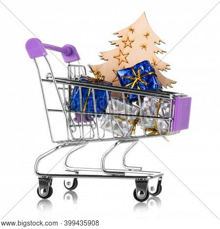 New Year's Sales. Shopping Cart With Gifts And Wooden Christmas Tree Isolated On White Background