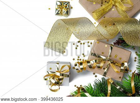 New Year Craft Gifts With Gold Ribbon, Serpentine, Christmas Branches And Stars Confetti Isolated On