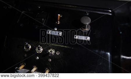 Vintage Control Panel With Levers. Media. Close-up Of Man Pressing Shift Levers On Control Panel Of