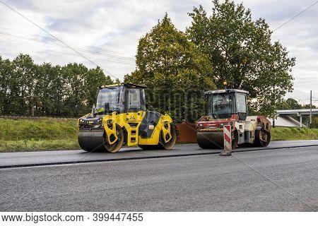 Kyiv, Ukraine - September 25, 2020: Two Heavy Asphalt Road Roller With Heavy Vibration Roller Compac