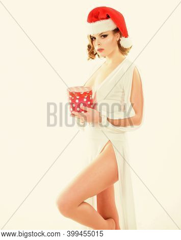 Girl Hold Box Opening Christmas Gift. Girl Celebrate Christmas. Girl Wear Santa Claus Hat. She Has P