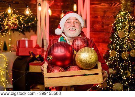 Elderly People. Decorating Home. Christmas Spirit. Christmas Decoration. Santa Claus. Mature Man Wit