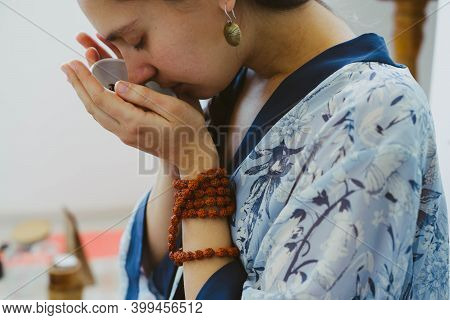 Tea Master Girl Listens To The Smell Of Chinese Tea. Tea Ceremony. Tea Puer According To Chinese Tra
