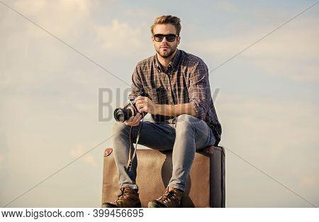 Shooting Vlog. Vacation Time. Travel Blog. Man Sit On Suitcase. Handsome Guy Traveler Retro Camera.