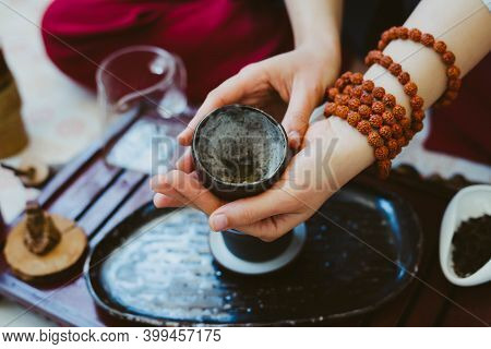 Tea Ceremony. Tea Master Brews Tea In Beautiful Chinese Dishes.