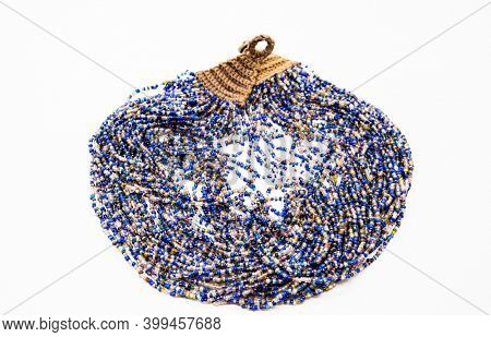 Beautiful beads, necklace made of glass beads, beads on white background. Very sophisticated handmade jewelry.