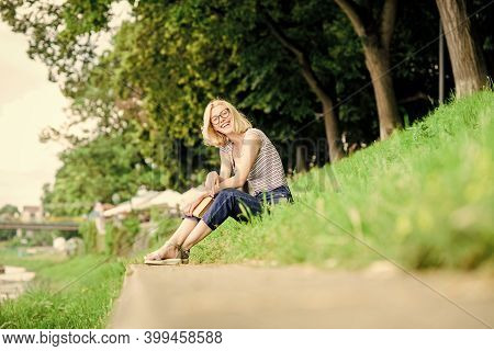 Literature For Summer Vacation. Girl Relaxing At Riverside After Working Day. Rest Relax And Hobby.