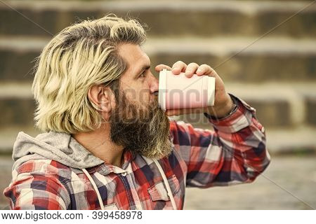 Having Rest. Man With Beard Drinking Coffee. Bearded Man Drink Beverage Urban Background. Hipster Re
