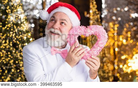 Charity And Kindness. Santa Claus. Kind Grandpa With Heart. Christmas Decoration. Love And Care. Mat