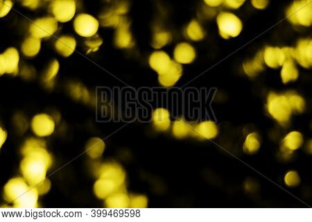 A Beautiful Image Of A Bokeh From New Years Garlands. Defocused Glitter Lighting Image For Art And D