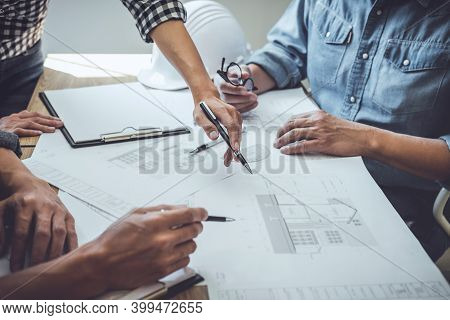 Engineer Teamwork Meeting, Drawing Working On Blueprint Meeting For Project Working With Partner On