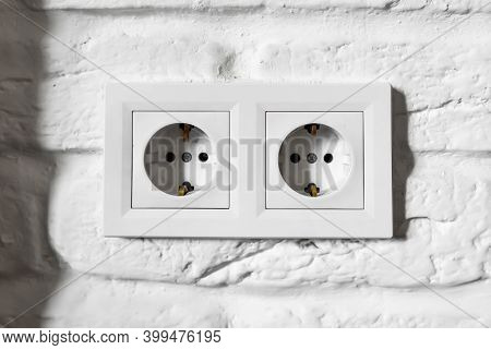 Plastic German Double Socket-outlets Type F With Grounding. Pair Of Empty, Unplugged, European White