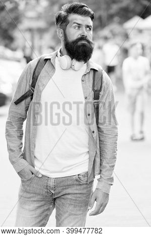 Brutal Guy Style. Bearded Man Urban Outdoors. Hipster In Casual Style. Headphones And Music Accessor