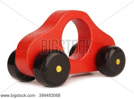 Vintage handmade red yellow wooden car toy isolated on white background