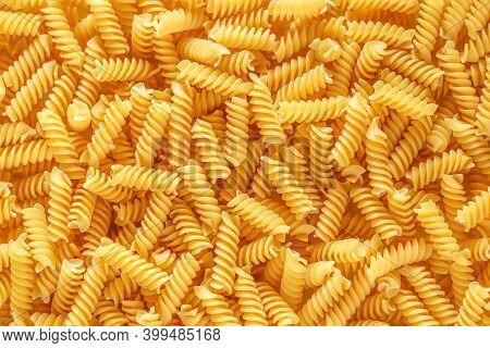 Dry Pasta Fusilli. Fusilli Have Spiral Shape And Yellow Color. Pasta Is Delicious Italian Traditiona