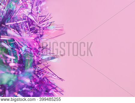 Tinsel Close Up Photo With Copy Space Shiny Lilac Tinsel On Pink Background Template For Posters And