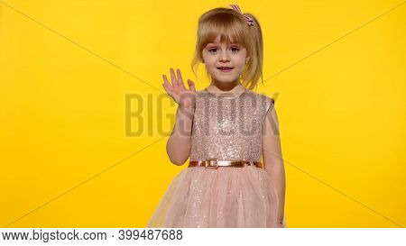 Friendly Little Blonde Child Kid Girl 5-6 Years Old With Fashion Makeup In Pink Shiny Dress, Waving